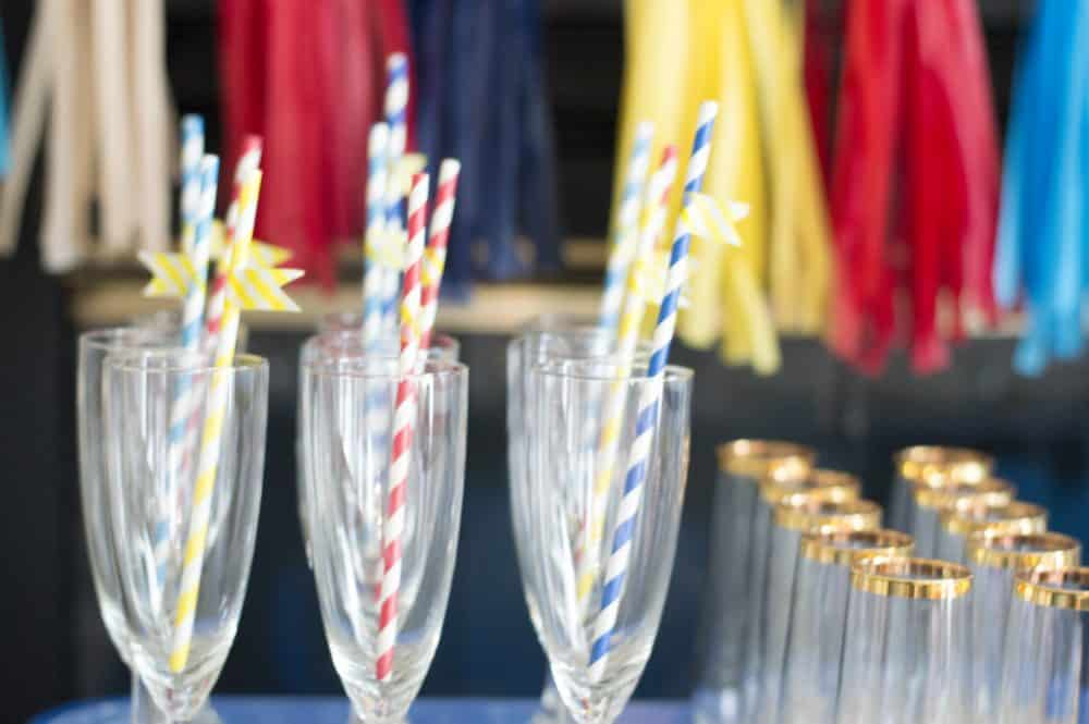 washi tape straws in champagne glasses
