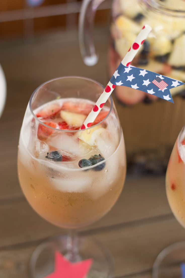 Rosé, White, and Blueberry Sangria with 4th of July Straw Flag