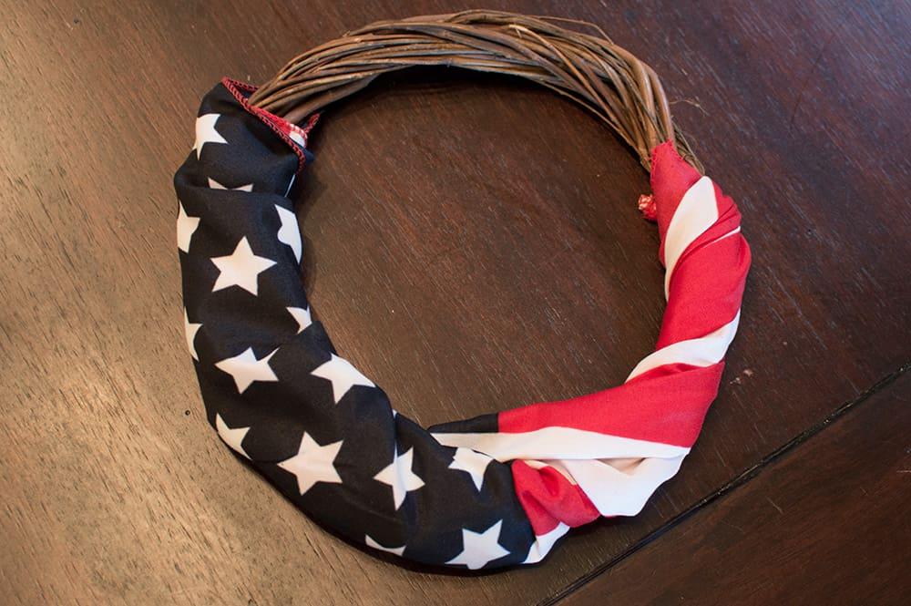 Step 2: Wrap Flag around your wreath -- DIY 4th of July Wreath from Elva M Design Studio