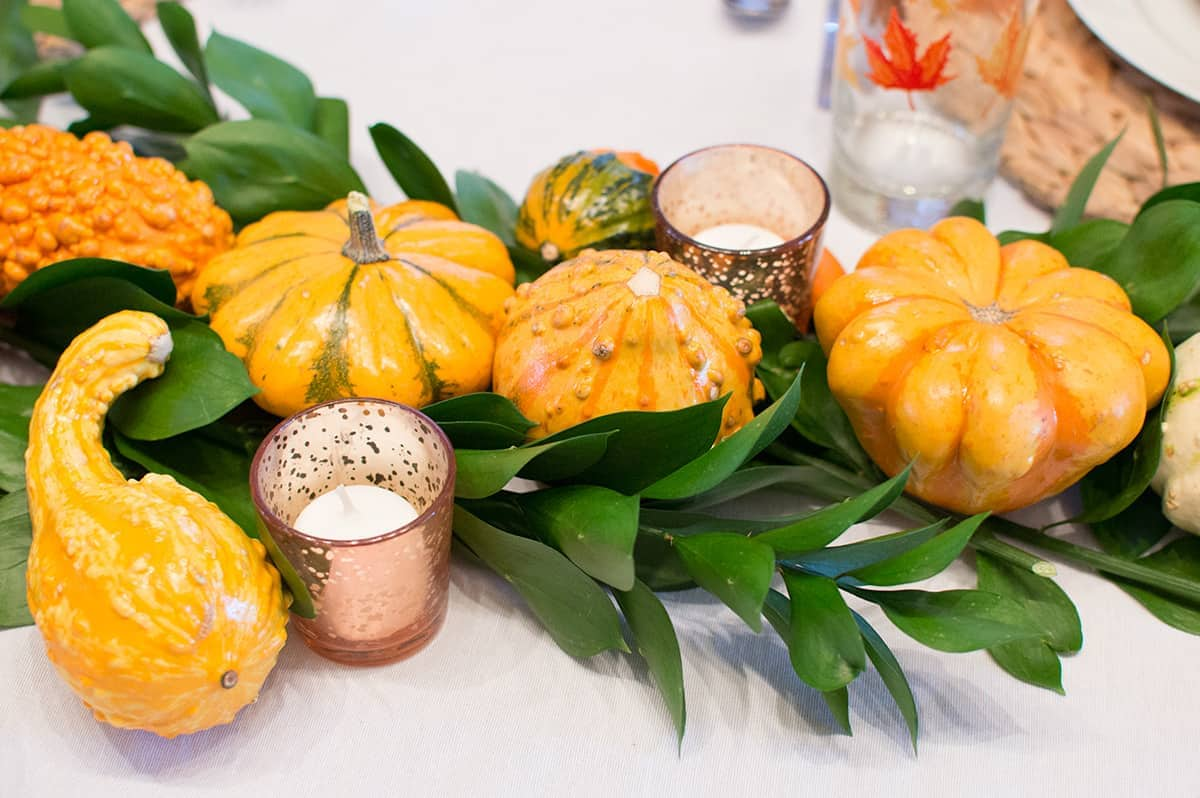 greenery and gourds on Thanksgiving Table