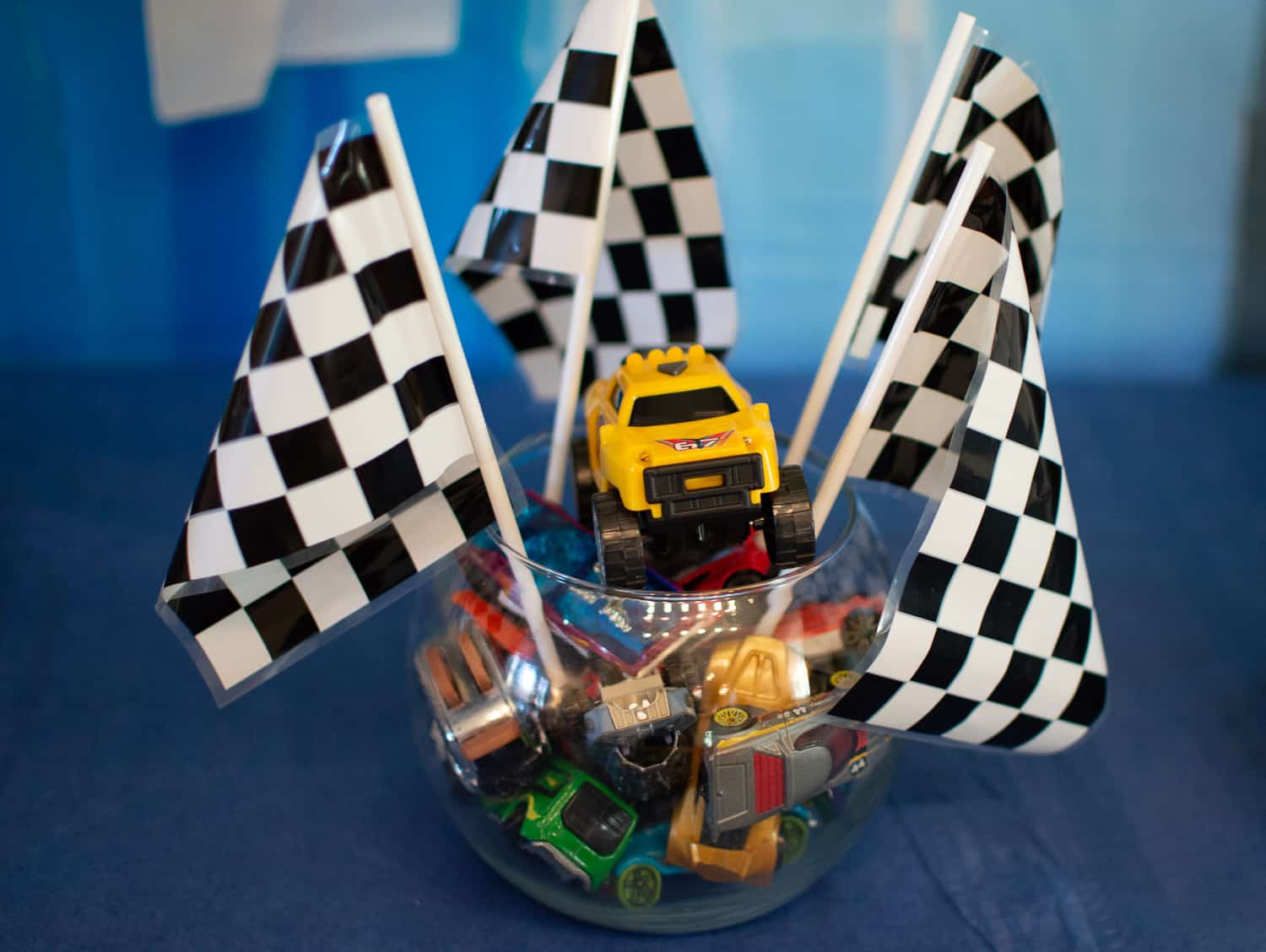 Checkered racing flag and truck centerpiece