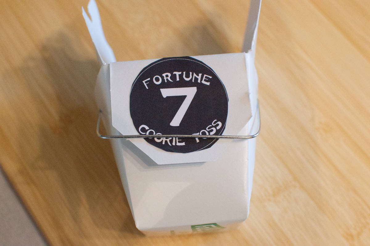 Glue Fortune Cookie Toss game pieces to takeout containers