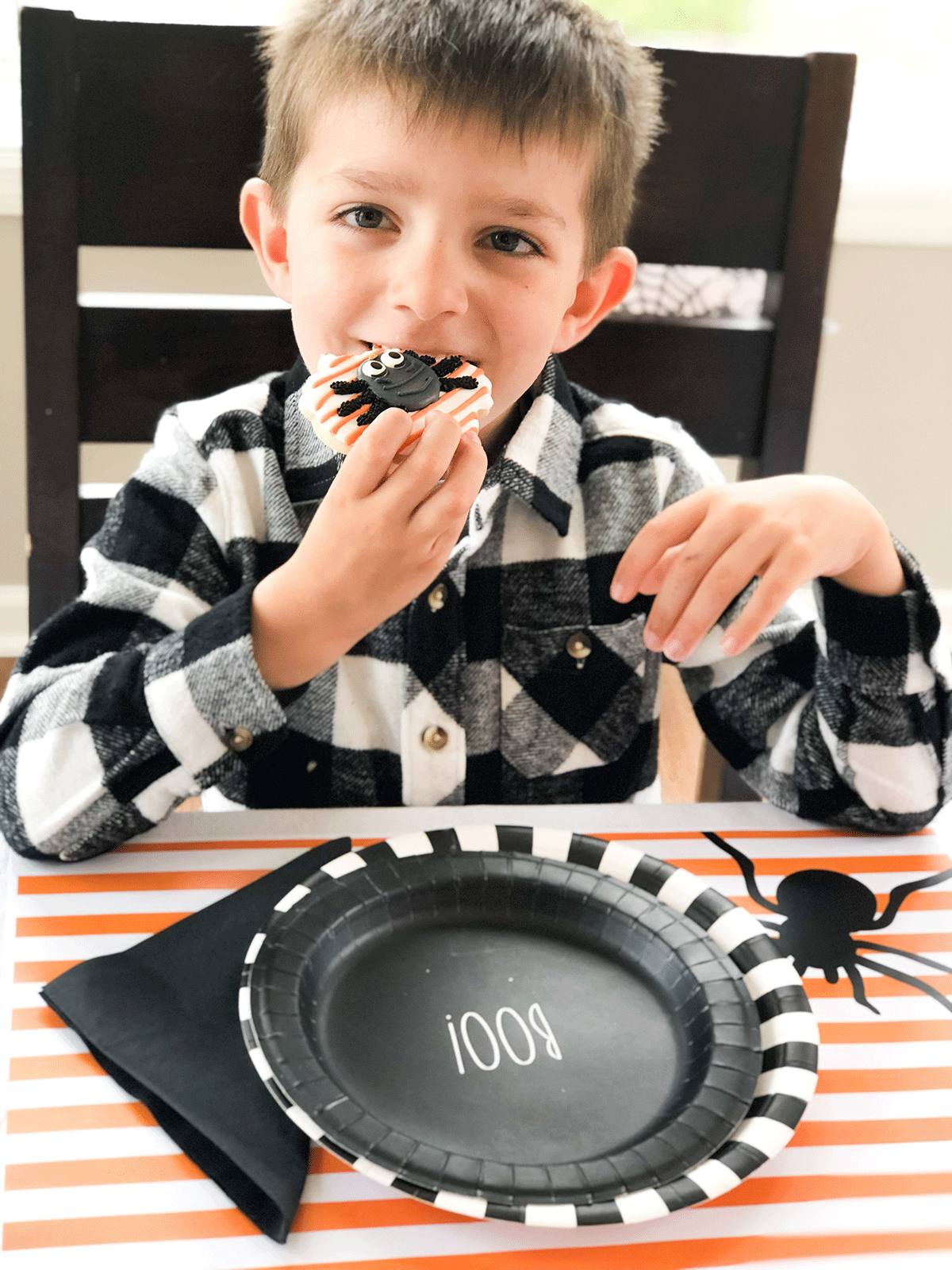 kid enjoying Halloween sugar cookie