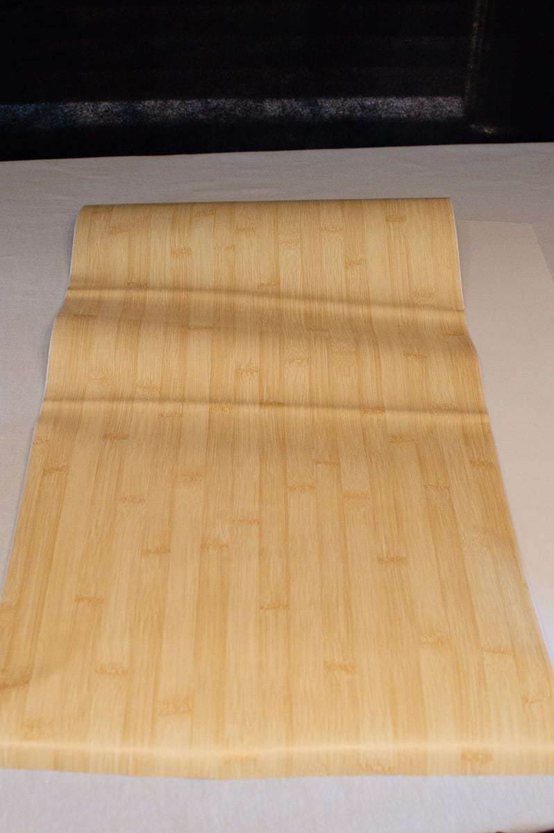 Attach the bamboo contact paper to the foam board