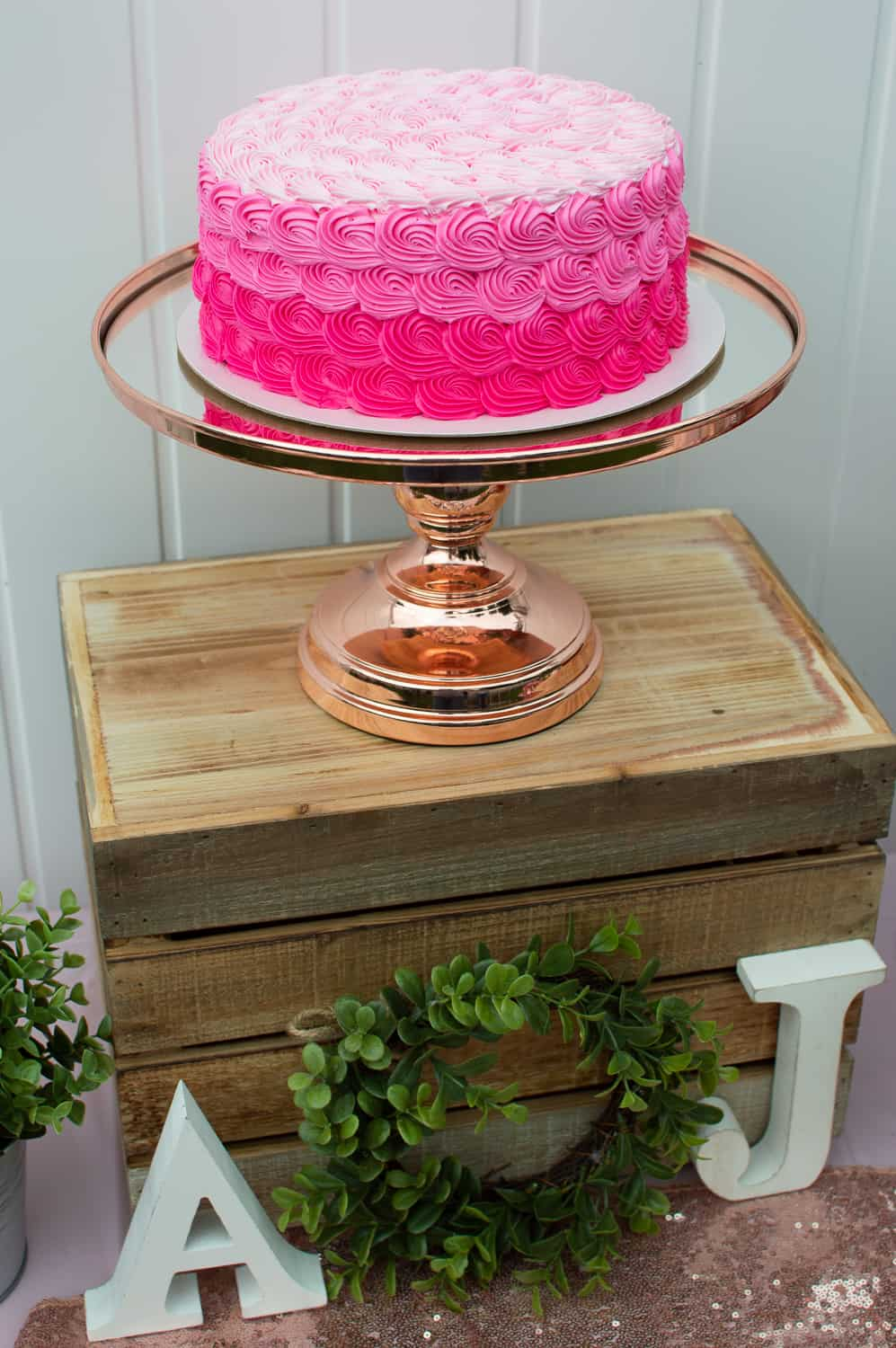 Amalfi Decor Rose Gold Cake Stand with pink rosette cake