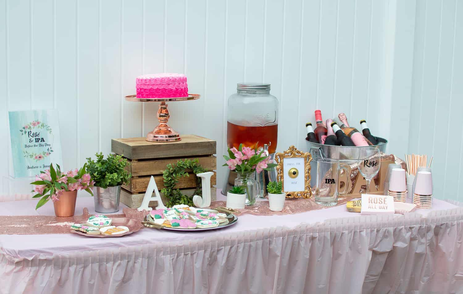 Rosé and IPA dessert and drinks table at a couples wedding shower