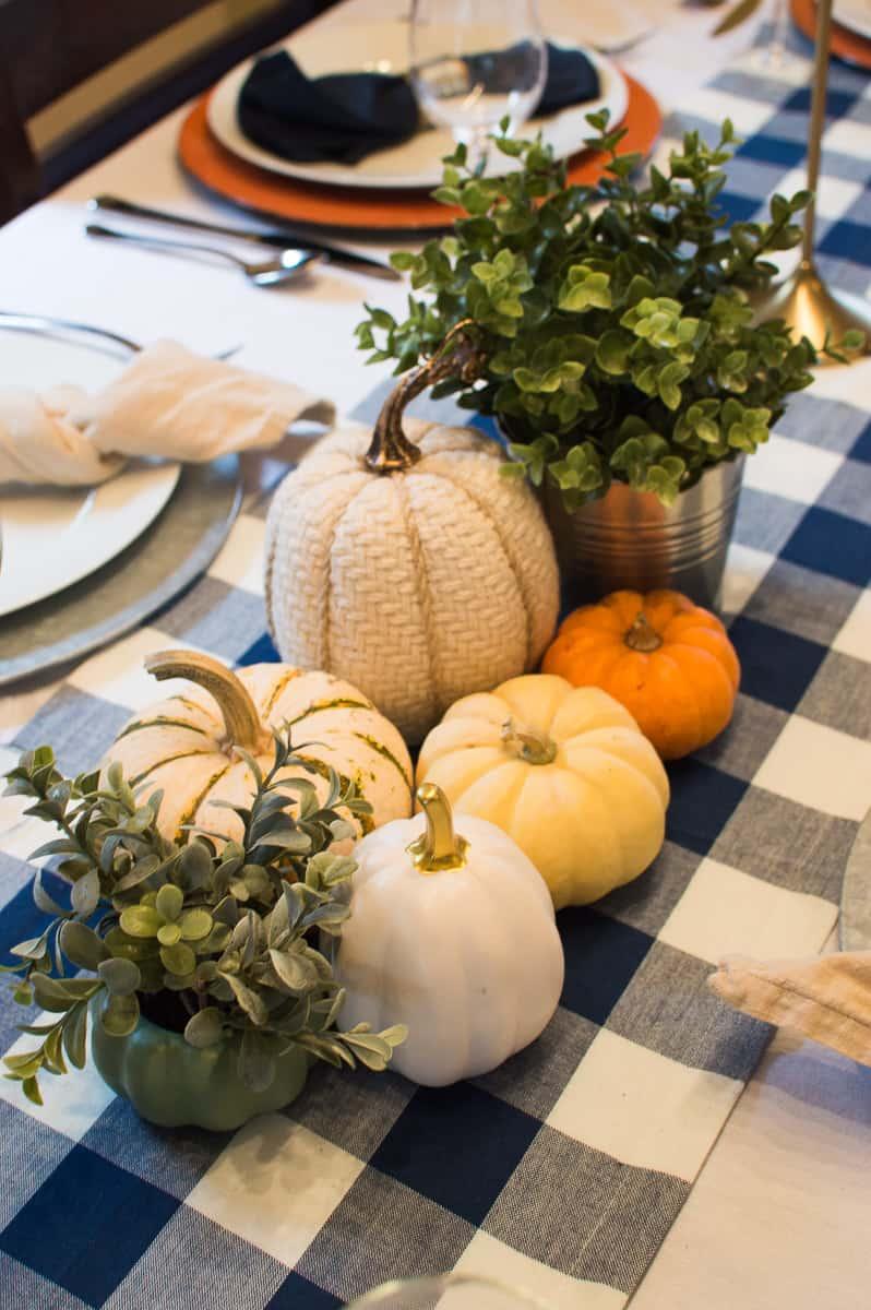 Thanksgiving pumpkin and greenery centerpiece